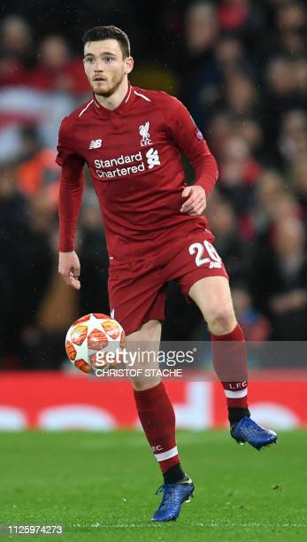 Liverpool's Scottish defender Andrew Robertson plays the ball during the UEFA Champions League round of 16 first leg football match between Liverpool...