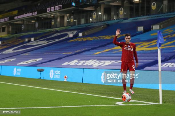 Liverpool's Scottish defender Andrew Robertson prepares to take a corner during the English Premier League football match between Brighton and Hove...