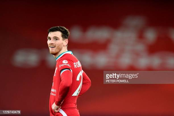Liverpool's Scottish defender Andrew Robertson reacts during the English Premier League football match between Liverpool and Leicester City at...