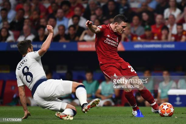 Liverpool's Scottish defender Andrew Robertson shoots as Tottenham Hotspur's English midfielder Harry Winks approaches during the UEFA Champions...