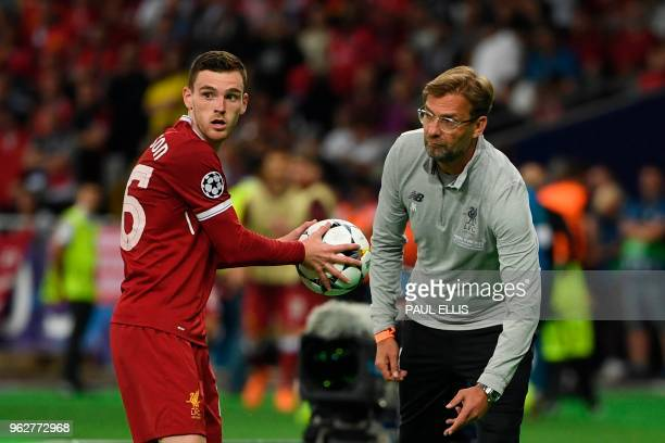 Liverpool's Scottish defender Andrew Robertson takes the ball from Liverpool's German manager Jurgen Klopp during the UEFA Champions League final...