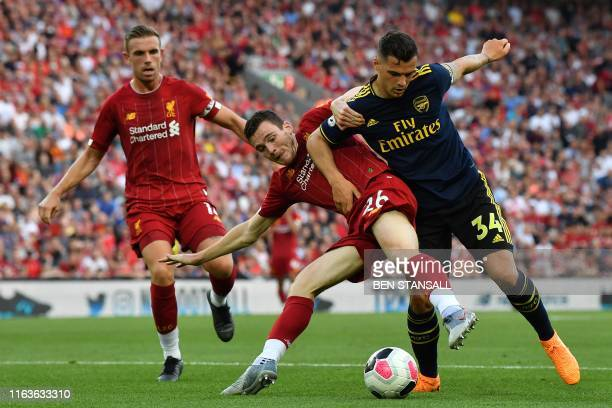Liverpool's Scottish defender Andrew Robertson vies with Arsenal's Swiss midfielder Granit Xhaka during the English Premier League football match...