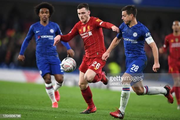 Liverpool's Scottish defender Andrew Robertson vies with Chelsea's Brazilian midfielder Willian and Chelsea's Spanish defender Cesar Azpilicueta...