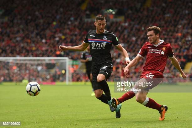Liverpool's Scottish defender Andrew Robertson vies with Crystal Palace's English defender Joel Ward during the English Premier League football match...