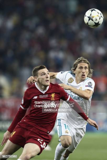 Liverpool's Scottish defender Andrew Robertson vies with Real Madrid's Croatian midfielder Luka Modric during the UEFA Champions League final...