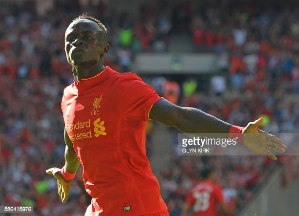Liverpool's Senegalese midfielder Sadio Mane celebrates after scoring the opening goal of the preseason International Champions Cup football match...