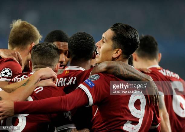 Liverpool's Senegalese midfielder Sadio Mane celebrates after scoring a goal on November 21 2017 at the Ramon Sanchez Pizjuan stadium in Sevilla...