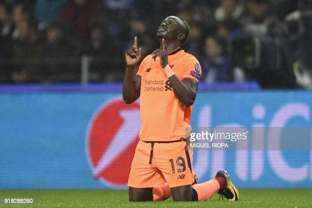 Liverpool's Senegalese midfielder Sadio Mane celebrates after scoring the opening goal of the UEFA Champions League round of sixteen first leg...