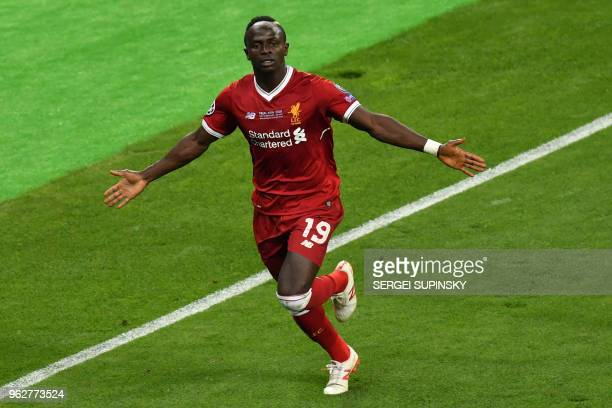 Liverpool's Senegalese midfielder Sadio Mane celebrates after scoring the 11 during the UEFA Champions League final football match between Liverpool...