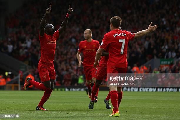 Liverpool's Senegalese midfielder Sadio Mane celebrates scoring his team's third goal during the English Premier League football match between...