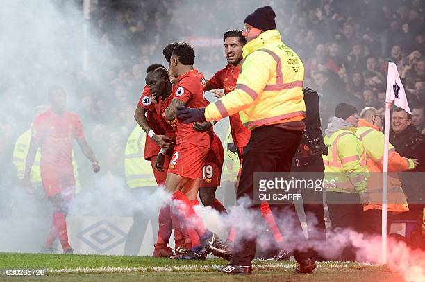 Liverpool's Senegalese midfielder Sadio Mane celebrates scoring his team's first goal during the English Premier League football match between...