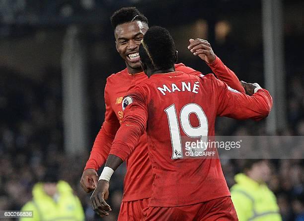 Liverpool's Senegalese midfielder Sadio Mane celebrates scoring his team's first goal with Liverpool's English striker Daniel Sturridge during the...