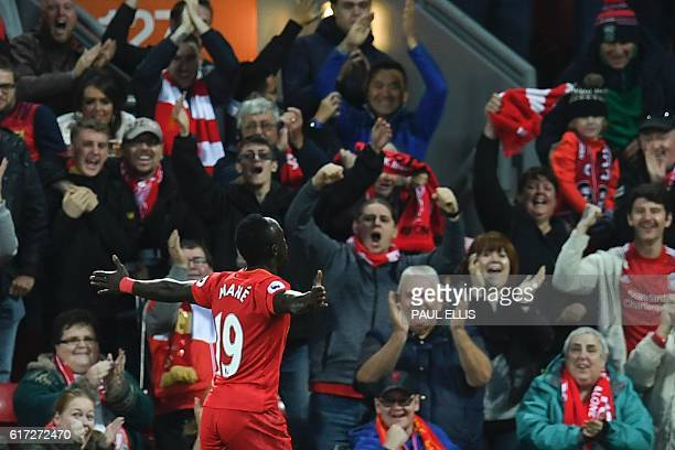 Liverpool's Senegalese midfielder Sadio Mane celebrates scoring the opening goal during the English Premier League football match between Liverpool...