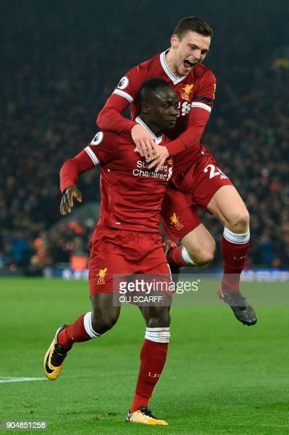 Liverpool's Senegalese midfielder Sadio Mane celebrates scoring their third goal to extend their lead 31 with Liverpool's Scottish defender Andrew...