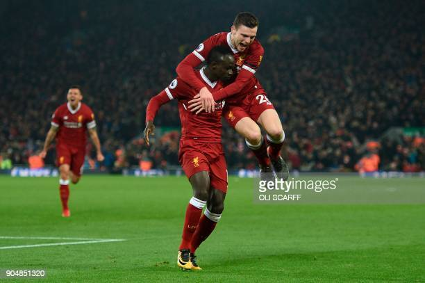Liverpool's Senegalese midfielder Sadio Mane celebrates scoring their third goal to extend their lead 31 with Liverpool's Scottish defender Andrew...