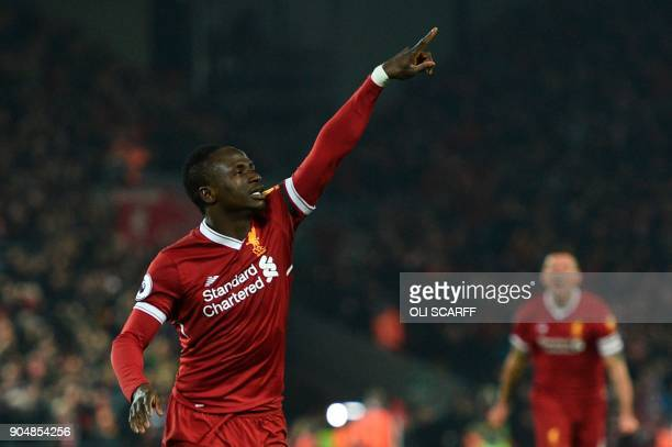 Liverpool's Senegalese midfielder Sadio Mane celebrates scoring their third goal to extend their lead 31 during the English Premier League football...
