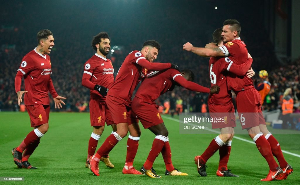 Liverpool's Senegalese midfielder Sadio Mane (3R) celebrates scoring their third goal during the English Premier League football match between Liverpool and Manchester City at Anfield in Liverpool, north west England on January 14, 2018. / AFP PHOTO / Oli SCARFF / RESTRICTED TO EDITORIAL USE. No use with unauthorized audio, video, data, fixture lists, club/league logos or 'live' services. Online in-match use limited to 75 images, no video emulation. No use in betting, games or single club/league/player publications. /