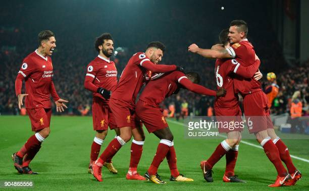 Liverpool's Senegalese midfielder Sadio Mane celebrates scoring their third goal during the English Premier League football match between Liverpool...