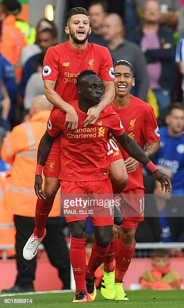 Liverpool's Senegalese midfielder Sadio Mane celebrates with Liverpool's English midfielder Adam Lallana after scoring their second goal during the...