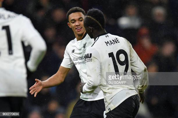 Liverpool's Senegalese midfielder Sadio Mane celebrates with Liverpool's English midfielder Trent AlexanderArnold after scoring the opening goal of...