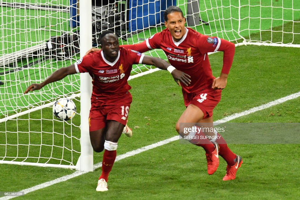 TOPSHOT - Liverpool's Senegalese midfielder Sadio Mane (L) celebrates with his teammate Liverpool's Dutch defender Virgil Van Dijk after scoring the 1-1 during the UEFA Champions League final football match between Liverpool and Real Madrid at the Olympic Stadium in Kiev, Ukraine on May 26, 2018.