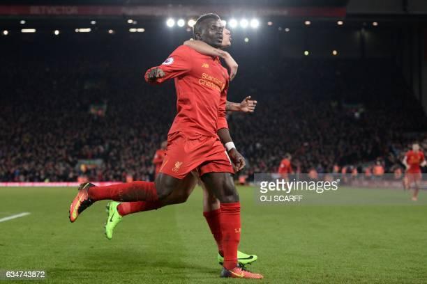Liverpool's Senegalese midfielder Sadio Mane celebrates with Liverpool's Brazilian midfielder Philippe Coutinho after scoring their second goal...