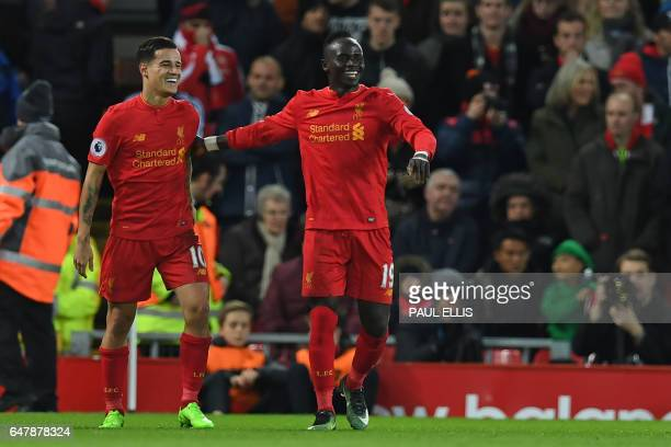 Liverpool's Senegalese midfielder Sadio Mane celebrates with Liverpool's Brazilian midfielder Philippe Coutinho after scoring their second goal...