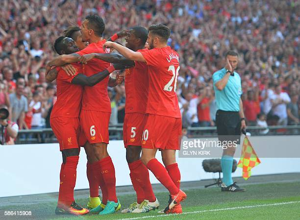 Liverpool's Senegalese midfielder Sadio Mane celebrates with teammates after scoring the opening goal of the preseason International Champions Cup...