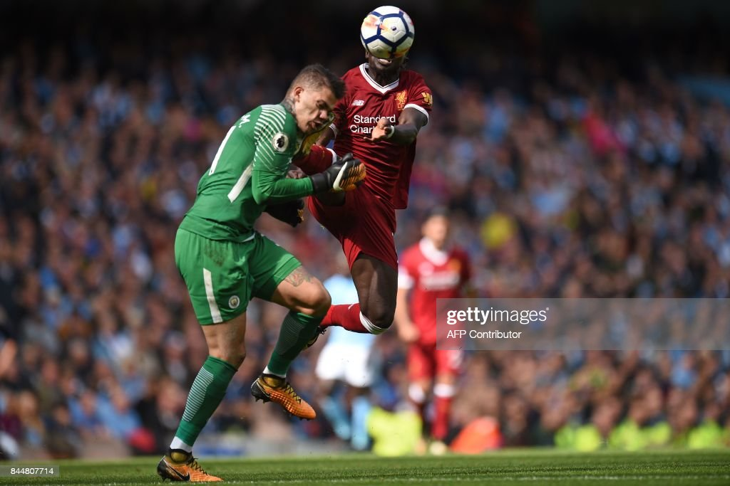 Liverpool's Senegalese midfielder Sadio Mane (R) is sent off for this challenge on Manchester City's Brazilian goalkeeper Ederson during the English Premier League football match between Manchester City and Liverpool at the Etihad Stadium in Manchester, north west England, on September 9, 2017. / AFP PHOTO / Oli SCARFF / RESTRICTED TO EDITORIAL USE. No use with unauthorized audio, video, data, fixture lists, club/league logos or 'live' services. Online in-match use limited to 75 images, no video emulation. No use in betting, games or single club/league/player publications. /