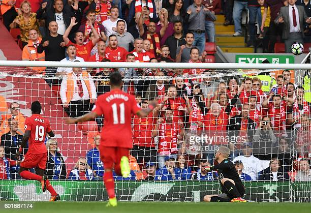 Liverpool's Senegalese midfielder Sadio Mane scores their second goal past Leicester City's Danish goalkeeper Kasper Schmeichel during the English...