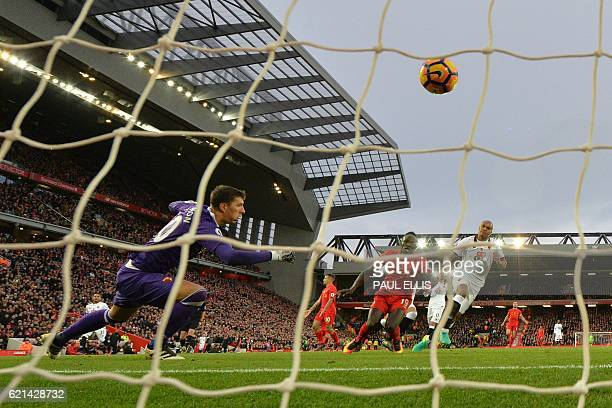 Liverpool's Senegalese midfielder Sadio Mane shoots past Watford's Romanian goalkeeper Costel Pantilimon to score his second and the team's fifth...