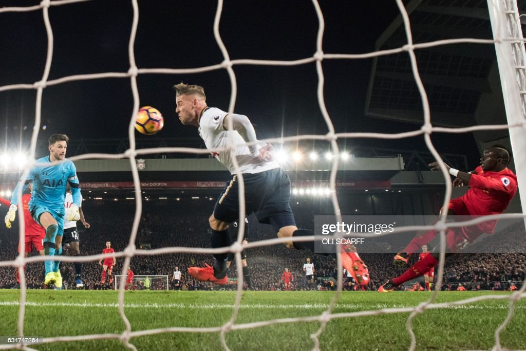 Liverpool's Senegalese midfielder Sadio Mane (R) shoots to score their second goal during the English Premier League football match between Liverpool and Tottenham Hotspur at Anfield in Liverpool, north west England on February 11, 2017. / AFP / Oli SCARFF / RESTRICTED TO EDITORIAL USE. No use with unauthorized audio, video, data, fixture lists, club/league logos or 'live' services. Online in-match use limited to 75 images, no video emulation. No use in betting, games or single club/league/player publications. /