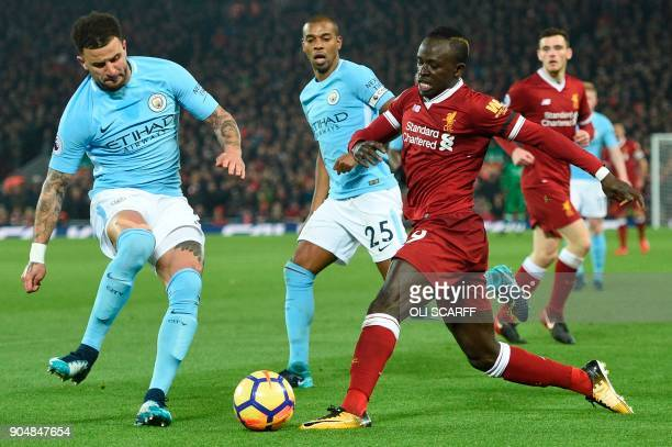 Liverpool's Senegalese midfielder Sadio Mane takes on Manchester City's English defender Kyle Walker and Manchester City's Brazilian midfielder...