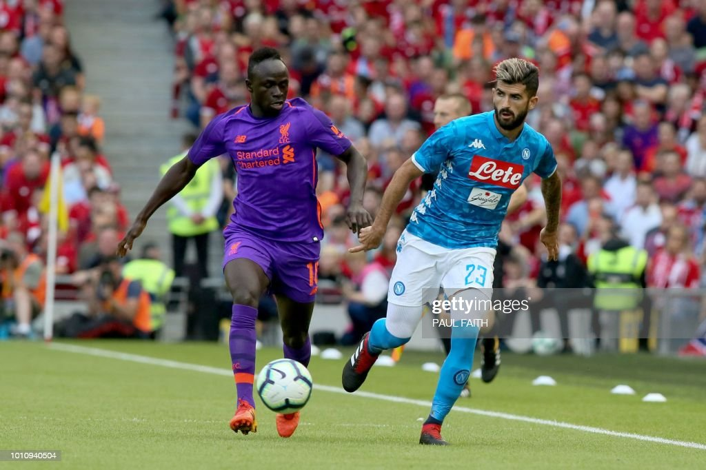 Liverpool's Senegalese midfielder Sadio Mane (L) takes on Napoli's Albanian defender Elseid Hysaj (R) during the pre-season friendly football match between Liverpool and Napoli at the Aviva Stadimum in Dublin on August 4, 2018.
