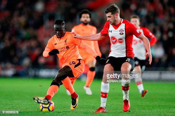 Liverpool's Senegalese midfielder Sadio Mane turns away from Southampton's English defender Jack Stephens during the English Premier League football...