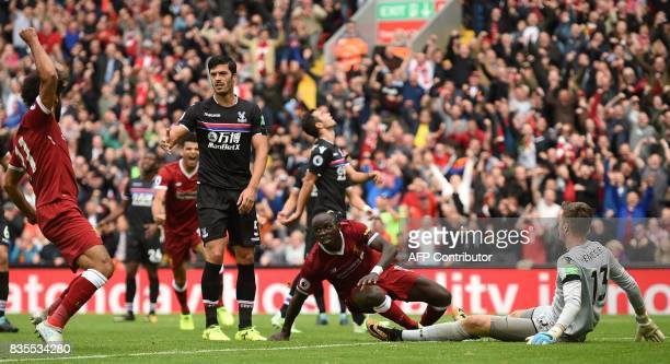 Liverpool's Senegalese midfielder Sadio Mane turns to celebrates with Liverpool's Egyptian midfielder Mohamed Salah after scoring the opening goal of...