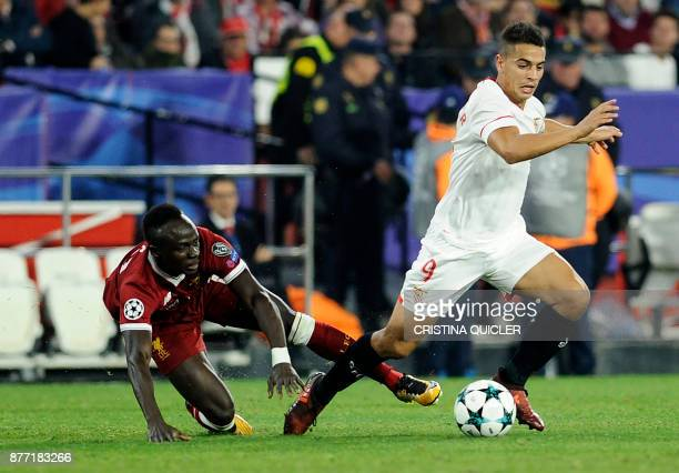 Liverpool's Senegalese midfielder Sadio Mane vies for the ball with Sevilla's French forward Wissam Ben Yedder on November 21 2017 at the Ramon...