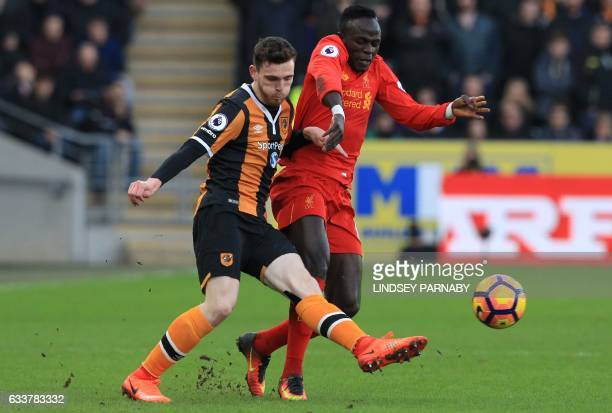 Liverpool's Senegalese midfielder Sadio Mane vies with Hull City's Scottish defender Andrew Robertson during the English Premier League football...