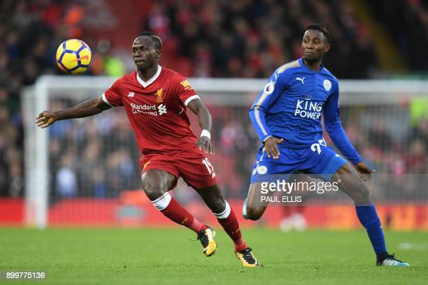 Liverpool's Senegalese midfielder Sadio Mane vies with Leicester City's Nigerian midfielder Wilfred Ndidi during the English Premier League football...