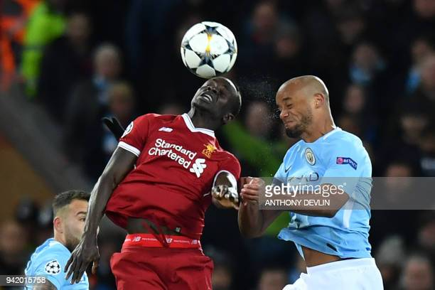 Liverpool's Senegalese midfielder Sadio Mane vies with Manchester City's Belgian defender Vincent Kompany during the UEFA Champions League first leg...