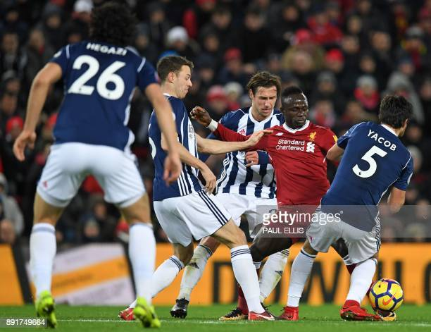 Liverpool's Senegalese midfielder Sadio Mane vies with West Bromwich Albion's Egyptian defender Ahmed Hegazy West Bromwich Albion's Northern Irish...
