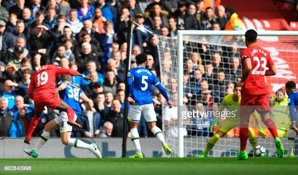 Liverpool's Senegalese midfielder Sadio Mane watches his shot beat Everton's Spanish goalkeeper Joel Robles for the opening goal of the English...