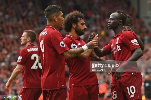 TOPSHOT Liverpool's Senegalese striker Sadio Mané celebrates with teammates after scoring their third goal during the English Premier League football...