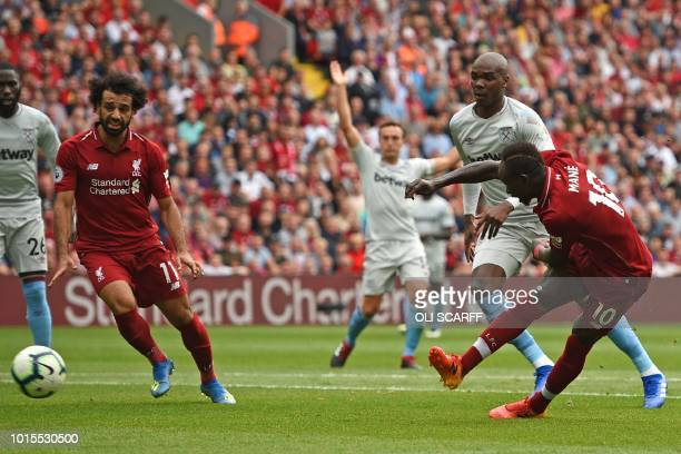 Liverpool's Senegalese striker Sadio Mané shoots to score their third goal during the English Premier League football match between Liverpool and...