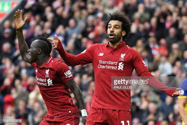 Liverpool's Senegalese striker Sadio Mane and Liverpool's Egyptian midfielder Mohamed Salah gesture during the English Premier League football match...