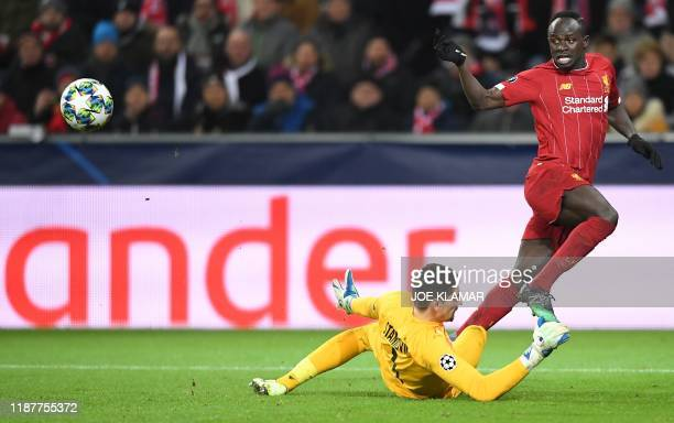 Liverpool's Senegalese striker Sadio Mane and Salzburg's Austrian goalkeeper Cican Stankovic vie for the ball during the UEFA Champions League Group...