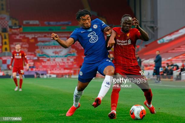 Liverpool's Senegalese striker Sadio Mane battles with Chelsea's English defender Reece James during the English Premier League football match...
