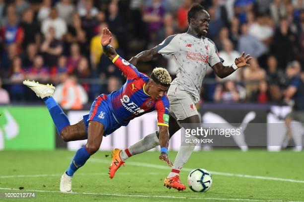 Liverpool's Senegalese striker Sadio Mane beats Crystal Palace's Dutch defender Patrick van Aanholt during the English Premier League football match...
