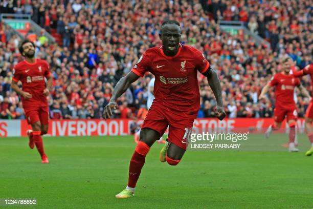 Liverpool's Senegalese striker Sadio Mane celebrates after he scores his team's second goal during the English Premier League football match between...