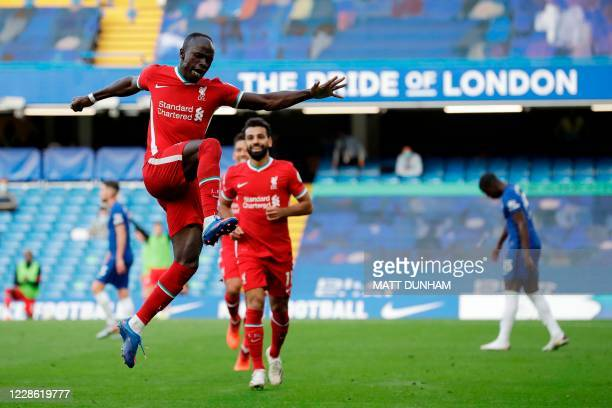 Liverpool's Senegalese striker Sadio Mane celebrates after scoring their second goal during the English Premier League football match between Chelsea...
